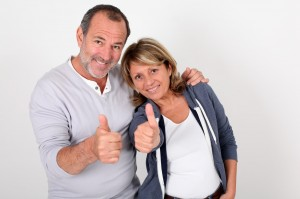 depositphotos_13940042-stock-photo-portrait-of-senior-couple-showing